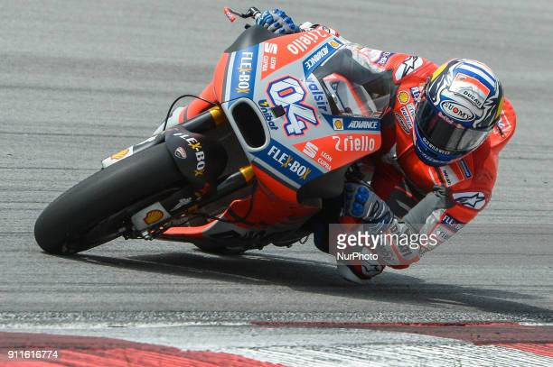 Ducati Team's rider Andrea Dovizioso of Italy rides his bike during the second day of the 2018 MotoGP preseason test at the Sepang International...