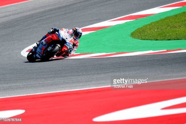 TOPSHOT Ducati Team's rider Italian Andrea Dovizioso leads during the MotoGP race of the San Marino Grand Prix at the Marco Simoncelli Circuit in...