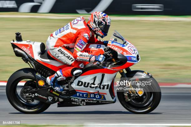 Ducati Team's rider Italian Andrea Dovizioso rides his bike during a qualifying session for the San Marino Moto GP Grand Prix race at the Marco...