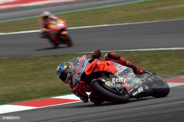 TOPSHOT Ducati Team's Spanish rider Jorge Lorenzo and Repsol Honda Team's Spanish rider Marc Marquez ride during the Catalunya MotoGP Grand Prix race...