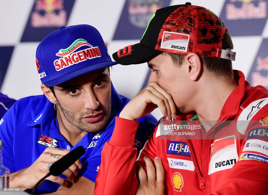 Ducati Team's Spanish rider Jorge Lorenzo (R) and Team SUZUKI ECSTAR's Italian rider Andrea Iannone attend a press conference during the Red Bull Grand Prix of Spain at Jerez de la Frontera race track on May 3, 2018.