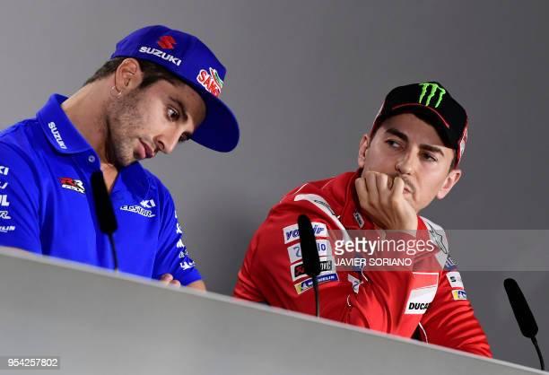 Ducati Team's Spanish rider Jorge Lorenzo and Team SUZUKI ECSTAR's Italian rider Andrea Iannone attend a press conference during the Red Bull Grand...
