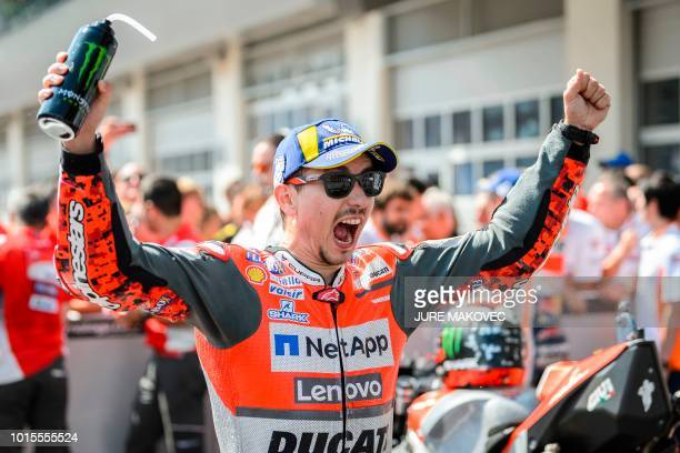 Ducati Team's Spanish rider Jorge Lorenzo celebrates after winning the Austrian MotoGP Grand Prix race at the Red Bull Ring in Spielberg Austria on...