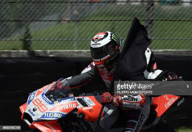 TOPSHOT Ducati Team's Spanish rider Jorge Lorenzo celebrates after winning the Moto GP Grand Prix at the Mugello race track on June 3 2018