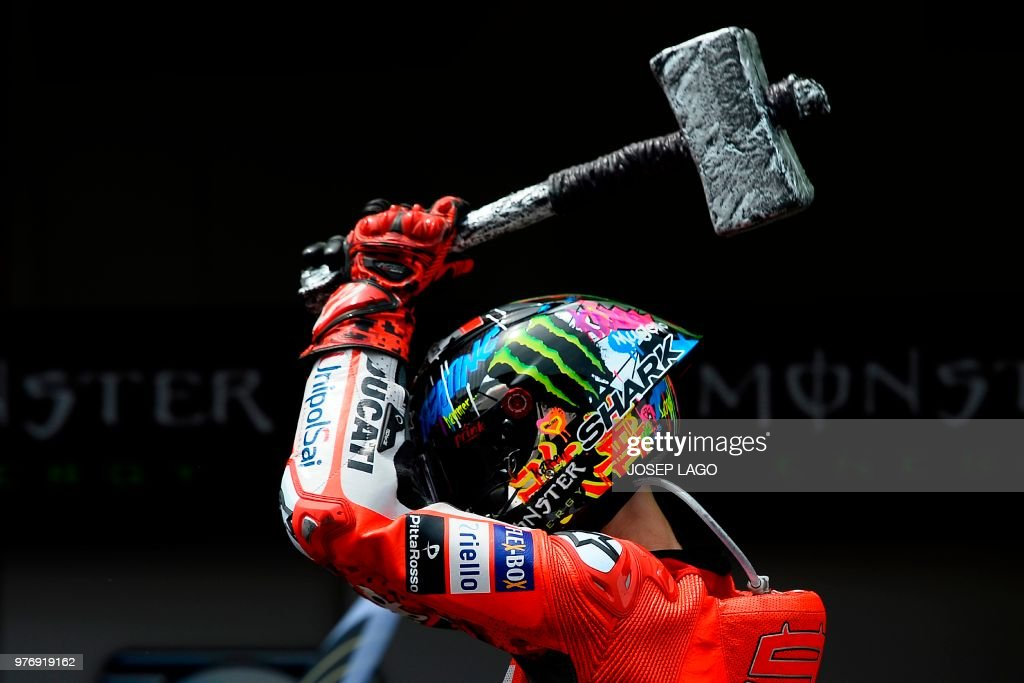 TOPSHOT - Ducati Team's Spanish rider Jorge Lorenzo celebrates after winning the Catalunya MotoGP Grand Prix race at the Catalunya racetrack in Montmelo, near Barcelona on June 17, 2018.