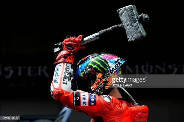TOPSHOT Ducati Team's Spanish rider Jorge Lorenzo celebrates after winning the Catalunya MotoGP Grand Prix race at the Catalunya racetrack in...