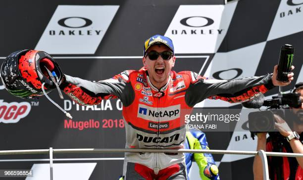 TOPSHOT Ducati Team's Spanish rider Jorge Lorenzo celebrates on the podium after winning the Moto GP Grand Prix at the Mugello race track on June 3...