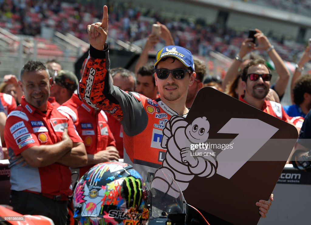 Ducati Team's Spanish rider Jorge Lorenzo celebrates taking the pole position of the Catalunya MotoGP Grand Prix qualifying session at the Catalunya racetrack in Montmelo, near Barcelona on June 16, 2018.
