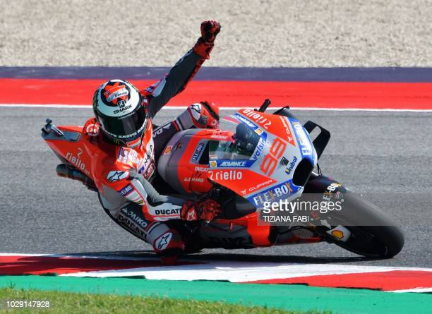 TOPSHOT Ducati Team's Spanish rider Jorge Lorenzo celebrates winning the pole position during the qualifying session of the San Marino MotoGP Grand...