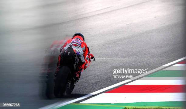 TOPSHOT Ducati Team's Spanish rider Jorge Lorenzo competes during the Moto GP Grand Prix at the Mugello race track on June 3 2018