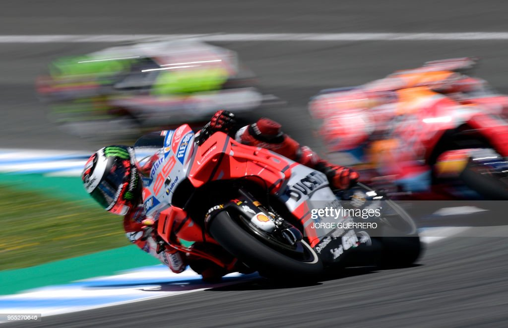 TOPSHOT - Ducati Team's Spanish rider Jorge Lorenzo competes during the MotoGP race of the Spanish Grand Prix at the Jerez Angel Nieto racetrack in Jerez de la Frontera on May 6, 2018.