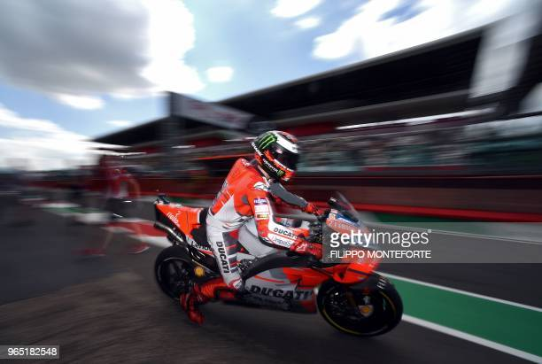 Ducati Team's Spanish rider Jorge Lorenzo exits the pit lane during a free practice session ahead of the Italian Moto GP Grand Prix at the Mugello...
