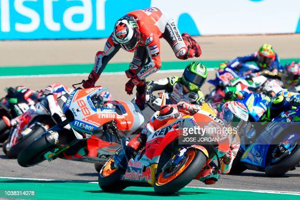 TOPSHOT Ducati Team's Spanish rider Jorge Lorenzo falls during MotoGP race of the Moto Grand Prix of Aragon at the Motorland circuit in Alcaniz on...