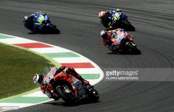 Ducati Team's Spanish rider Jorge Lorenzo leads Ducati Team's Italian rider Andrea Dovizioso, Movistar Yamaha's Italian rider Valentino Rossi and...