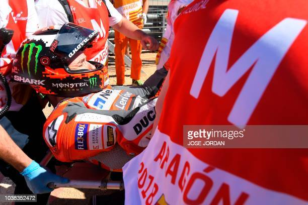 Ducati Team's Spanish rider Jorge Lorenzo receives medical assistance after falling during MotoGP race of the Moto Grand Prix of Aragon at the...