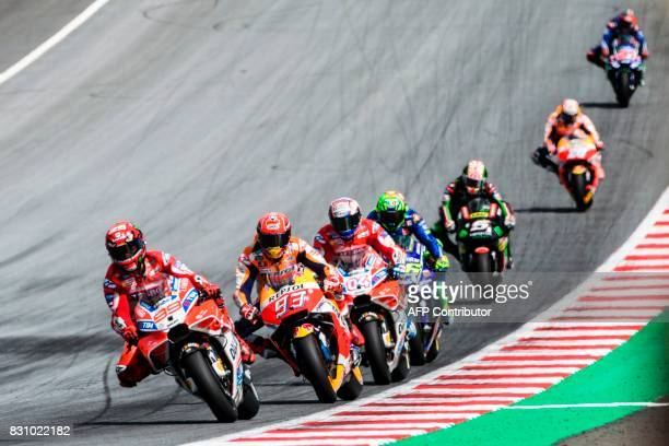 Ducati Team's Spanish rider Jorge Lorenzo Repsol Honda Team's Spanish rider Marc Marquez Ducati Team's Italian rider Andrea Dovizioso Movistar Yamaha...