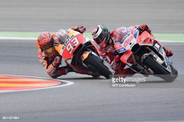 Ducati Team's Spanish rider Jorge Lorenzo rides ahead of Repsol Honda Team's Spanish rider Marc Marquez during the Moto GP second free pratice of the...