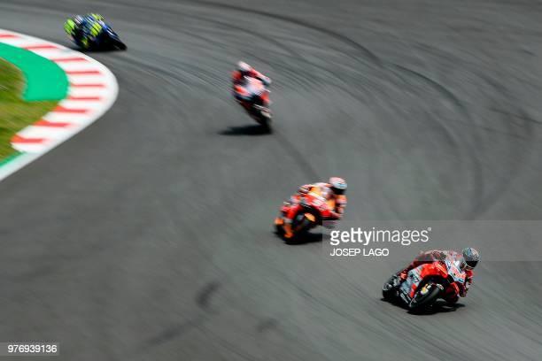 TOPSHOT Ducati Team's Spanish rider Jorge Lorenzo rides ahead of Repsol Honda Team's Spanish rider Marc Marquez during the Catalunya MotoGP Grand...
