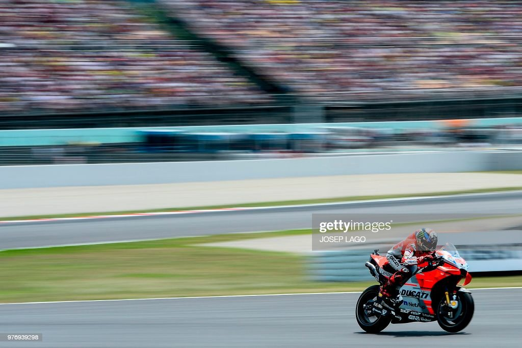 TOPSHOT - Ducati Team's Spanish rider Jorge Lorenzo rides during the Catalunya MotoGP Grand Prix race at the Catalunya racetrack in Montmelo, near Barcelona on June 17, 2018. (Photo by Josep LAGO / AFP) / The erroneous mention[s] appearing in the metadata of this photo by Josep LAGO has been modified in AFP systems in the following manner: [---] instead of [---]. Please immediately remove the erroneous mention[s] from all your online services and delete it (them) from your servers. If you have been authorized by AFP to distribute it (them) to third parties, please ensure that the same actions are carried out by them. Failure to promptly comply with these instructions will entail liability on your part for any continued or post notification usage. Therefore we thank you very much for all your attention and prompt action. We are sorry for the inconvenience this notification may cause and remain at your disposal for any further information you may require.