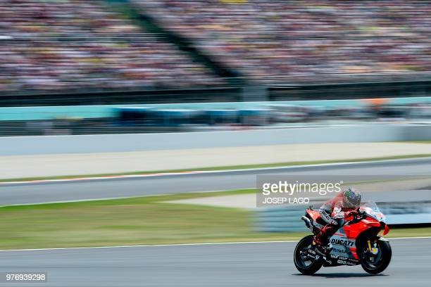 TOPSHOT Ducati Team's Spanish rider Jorge Lorenzo rides during the Catalunya MotoGP Grand Prix race at the Catalunya racetrack in Montmelo near...