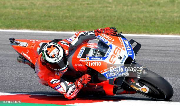 Ducati Team's Spanish rider Jorge Lorenzo takes a curve during the free practice session of the San Marino Moto GP Grand Prix race at the Marco...