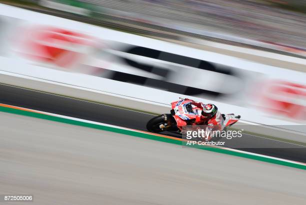 TOPSHOT Ducati Team's Spanish rider Jorge Lorenzo takes a curve during the second MotoGP free practice session of the Valencia Grand Prix at Ricardo...