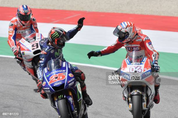 Ducati's Andrea Dovizioso celebrates with Movistar Yamaha's Spanish rider Maverick Vinales second and OCTO Pramac Yakhnich's Italian rider Danilo...