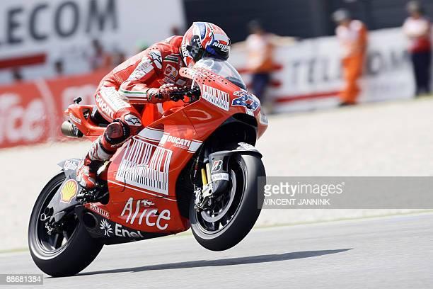 Ducati's Australian Casey Stoner is pictured during the first MotoGP free practice ahead of the Saturday Dutch TT Grand Prix held in Assen racetrack...