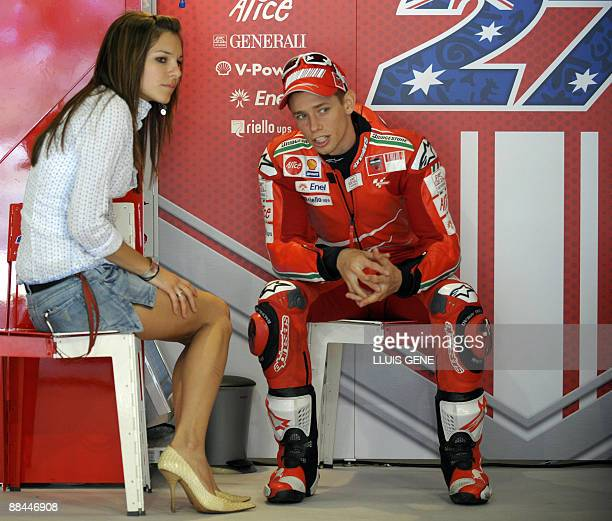 Ducati´s Australian Casey Stoner talks with his wife Adriana in the pits during the Moto GP training session of the Catalunya Grand Prix at the...