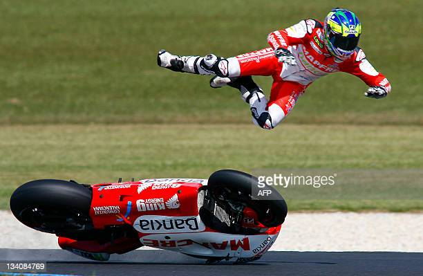 Ducati's Damien Cudlin of Australia crashes out of the third practice session of the Australian Grand Prix motorcycling MotoGP race at Phillip Island...