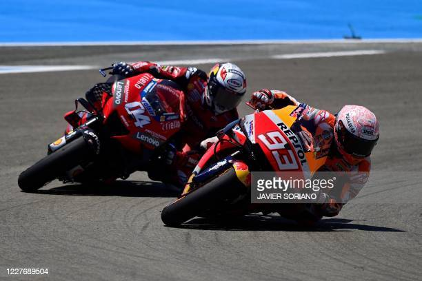 Ducati's Italian rider Andrea Dovizioso and Repsol Honda Team's Spanish rider Marc Marquez compete during the MotoGP race of the Spanish Grand Prix...