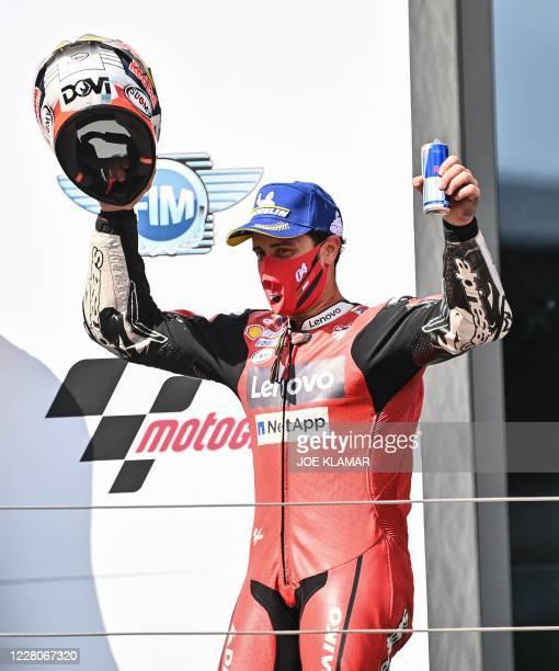 Ducati's Italian rider Andrea Dovizioso celebrates during the winner's ceremony of the Moto GP Austrian Grand Prix at the Red Bull Ring circuit in...