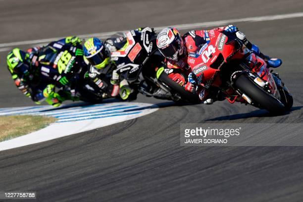 Ducati's Italian rider Andrea Dovizioso, Reale Avintia Racing's Spanish rider Tito Rabat and Monster Energy Yamaha's Italian rider Valentino Rossi...