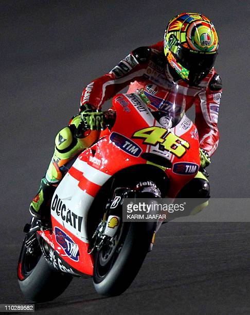 Ducati's MotoGP rider Valentino Rossi of Italy takes part in the free practice at the Losail International Circuit in the Qatari capital Doha on...