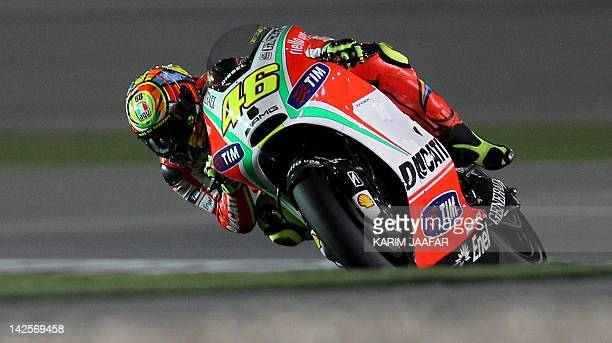 Ducati's MotoGP rider Valentino Rossi of Italy takes part in the free practice session at the Losail International Circuit in the Qatari capital Doha...