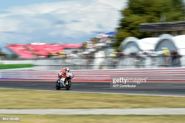 Ducati's rider Italian Andrea Dovizioso takes part in the free practice session at the Marco Simoncelli Circuit ahead of the San Marino Moto GP Grand...