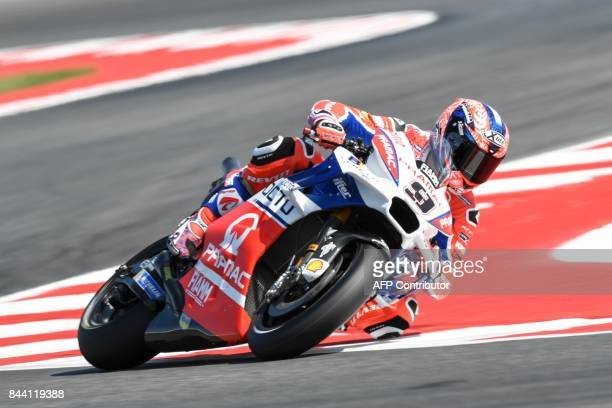 TOPSHOT Ducati's rider Italian Danilo Petrucci competes during the free practice session at the Marco Simoncelli Circuit ahead of the San Marino Moto...