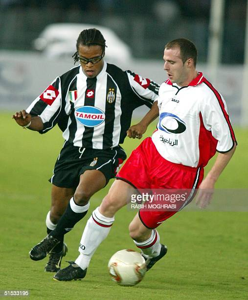 Duch midfielder Edgar Davids of Juventus fights for the ball with Bulent Kormaz of the All Stars team during the testimonial match of United Arab...