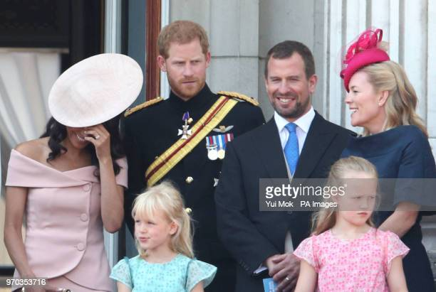 Duchess and Duke of Sussex, with Peter and Autumn Phillips, and daughters Isla and Savannah, on the balcony of Buckingham Palace, in central London,...