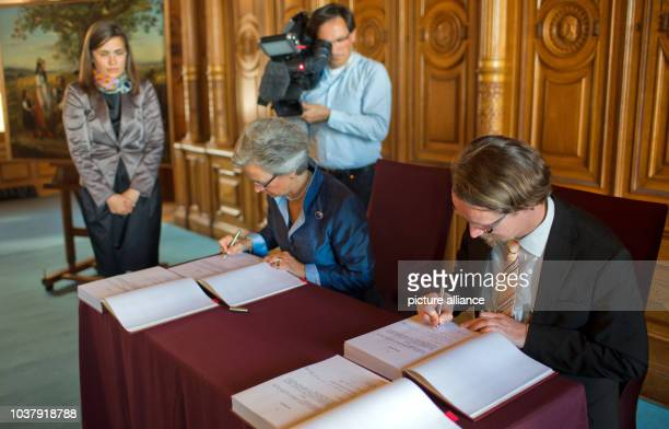 Duchess Donata Herzogin zu Mecklenburgvon Solodkoff and MecklenburgWestern Pomerania Culture Minister Mathias Brodkorb sign the purchase agreement of...