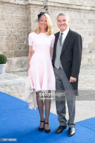 Duchess Elizabeth of Bavaria and Herr Dr Daniel Terberger arrive at the SaintQuirin Church for the wedding of Duchess Sophie of Wurttemberg and Count...