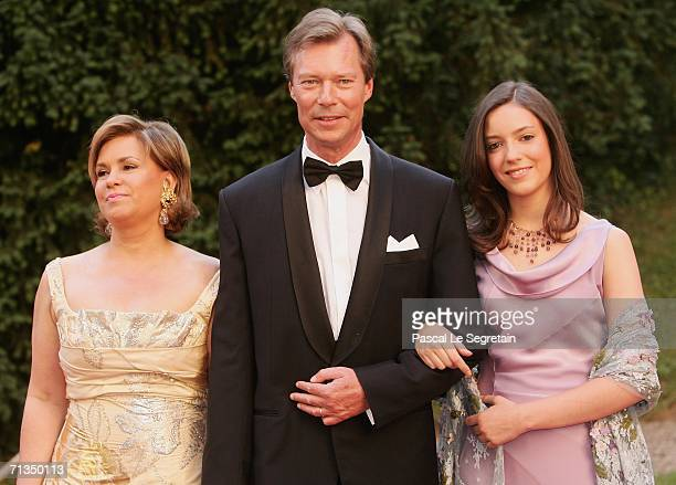 Duchess Maria Teresa of Luxembourg Grand Duke Henri of Luxembourg and Princess Alexandra of Luxembourg pose as they arrive to attend a royal dinner...