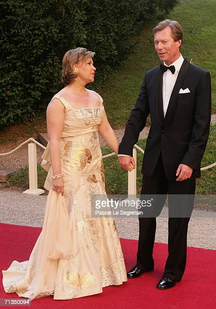 Duchess Maria Teresa of Luxembourg Grand Duke Henri of Luxembourg pose as they arrive to attend a royal dinner as part of the Grand Duke Henri of...