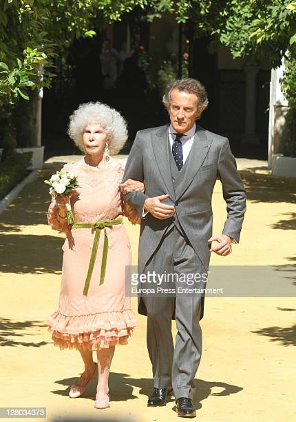 Duchess of Alba Cayetana FitzJames Stuart and Alfonso Diez leave Duenas Palace to welcome people on October 5 2011 in Seville Spain