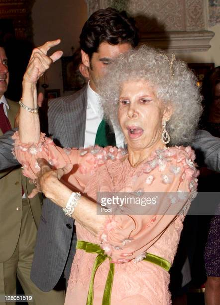 Duchess of Alba Maria del Rosario Cayetana FitzJamesStuart dances with bullfighter Francisco Rivera Ordoñez after her wedding to Alfonso Diez...