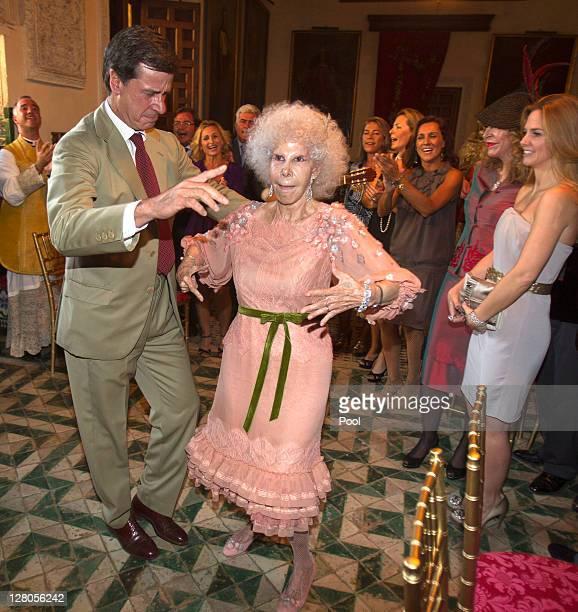 Duchess of Alba Maria del Rosario Cayetana FitzJamesStuart dances with son Cayetano Martinez de Irujo during her wedding ceremony to Alfonso Diez...