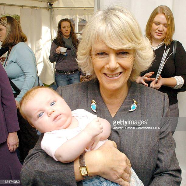 HRH Duchess of Cornwall holds 3 month old Shannon Williams during her visit to the charity GFS Platform's home for teenage mothers in Bromley...