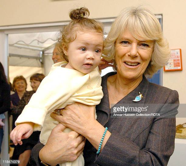 HRH Duchess of Cornwall holds 5 month old Renee Mason during her visit to the charity GFS Platform's home for teenage mothers in Bromley southeast...