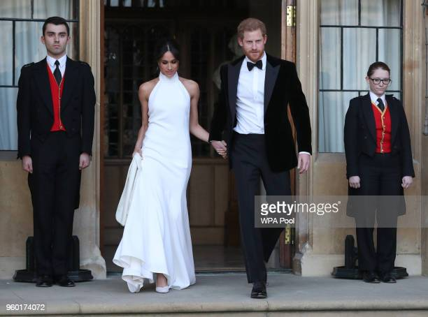 Duchess of Sussex and Prince Harry Duke of Sussex leave Windsor Castle after their wedding to attend an evening reception at Frogmore House hosted by...