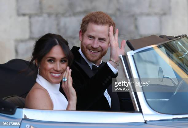 Duchess of Sussex and Prince Harry, Duke of Sussex wave as they leave Windsor Castle after their wedding to attend an evening reception at Frogmore...